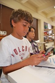 6th grade student Nico Laurie calculates his monthly budget.