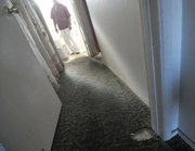 A Dario Pini tenant who has repeatedly asked for new paint and carpeting. This patch in the hallway appears to not only be worn but also without padding, and the carpet looks like it had been previously installed at a different location. (Dec. 12, 2012)