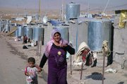 A Syrian Kurd and her child in the Camp Domiz refugee camp in Iraqi Kurdistan. Since April, some 29,000 Syrian Kurds fleeing the war in Syria have been given asylum at Camp Domiz.