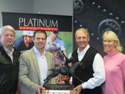 Owners of the Circle JB Polo Ranch in Buellton and hosts of the Annual Santa Ynez Valley Polo Classic, Joel and Charlotte Baker, present the Perpetual Polo Classic Trophy to Mark and Doug Herthel, sponsors of the 2012 winning team, Platinum Performance.