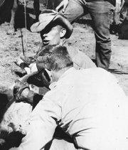 Glenn Parks (in hat) in the Orella Ranch corrals, 1961.