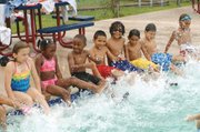 Kids swim class kicking.