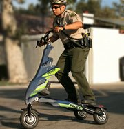 From Trikke&#39;s official website, a law enforcement officer rides one of their electric scooters