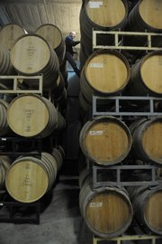 GM Jim Adelman high up in the barrel room.