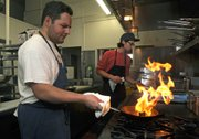 Sama Sama chef/co-ownerRicardo Aguilar works the flames.