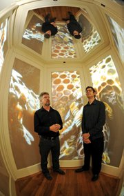 "Ethan Turpin (right) and Jonathan Smith stood inside their collaborative creation ""Bee Cell."""