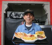 Stan Nicolaides offers his mac & cheese at the Greek House.