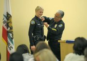 Officer Carter gets her new badge pinned by Chief Cam Sanchez.