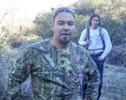 Hunters Krueter and Lowe shortly after Krueter shot and killed Billy the Dog.