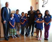 Randy Weiss and Cam Sanchez with Goleta and Westside Boys and Girls Clubs kids during annual community breakfast.