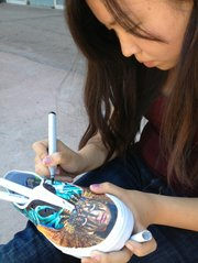 Yuliana Salazar painting the music shoe