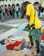"John Danner, AKA ""JD"" photographing chalk art painting by Joy Lynn Davis."