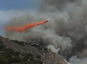 An air tanker drops a line of retardant to fight the White Fire (May 28, 2013)