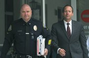 Officer Jaycee Hunter and attorney Sanford Horowitz leave the courthouse (July 1, 2013)