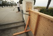 Wooden barricades meant to close the park were moved or destroyed