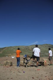 "<b>WEEKEND GETAWAY:</b>  (from left) Luis Arias fires downrange as Javier Rios and Fabian Iniguez look on at the Arroyo Burro ""Glass Factory"" shooting range."