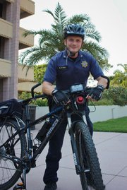 Corporal Matt Stern, of the UCSB Police Department, takes a break from his bike patrol on campus.