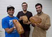 Genuine Bread Co.'s Geoff Jensen (left to right), Andrew Elia and Jeff Appareti outside of the French Press where they sell their loaves every Tuesday and Saturday.