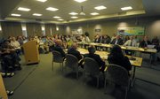 More than 100 people showed up last at Wednesday's emergency meeting, and an overflow room opened up. The discussion was long on specifics about possible cuts, but much shorter about the search for other funding sources or the pursuit of legislative remedies.