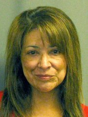 Paula Lopez booking photo (July 29, 2013)