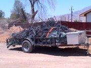 Trash and irrigation tubing discovering during marijuana eradication in Cuyama Valley