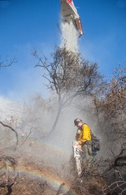 Cold Fire--lead sawyer gets hit from a water drop called in to cool down a hot spot.