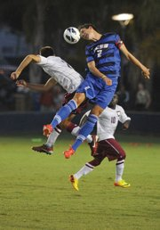 <b>HEADSTRONG:</b> Senior Peter Schmetz took control of the ball using his forehead in a game against Westmont. Played at UCSB's Harder Stadium, the game brought out more than 3,000 spectators.