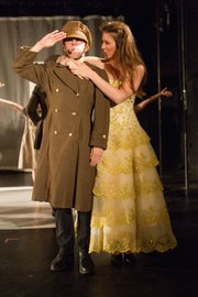 <b>AN OFFICER AND A SOPRANO:</b>  Megan Silberstein vamps while Ben Offringa salutes in <i>The Pirates of Penzance</i>.