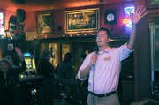 Jason Nelson sings karaoke Wednesday night at Bo Henry's bar