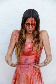 <b>SPLAT: </b> As the lead in <i>Carrie</i>, Julia Kupiec copes with some stage blood.