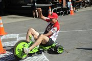 City Administrator Jim Armstrong wins the big wheel race