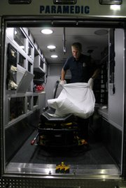 A paramedic gets ready for the next call-out