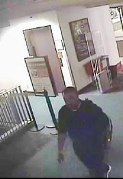 Police are looking for this man, seen here in surveillance footage at the downtown library
