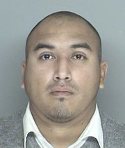 Raymond Morua booking photo (12/06/2013)