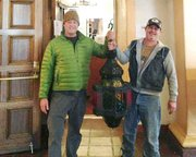Tom Houghtaling and Michael Junk hold the Arlington lamp that went missing Christams Eve 2011 and was found at a yard sale.