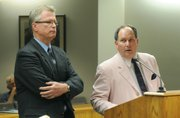 Prosecutor Arnis Tolks (left) and defense attorney Darryl Genis