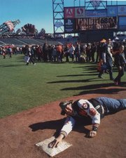 Craig Harris tumbles across home plate at the Giants' Fanfest 2014.