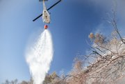 Chopper 3 making a water drop during the Cold Fire in the mountains behind Montecito last year.