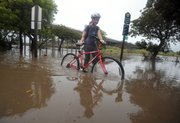 It takes more than a flooded bike path to keep UCSB physics grad student Katharine Hyatt from going to class.