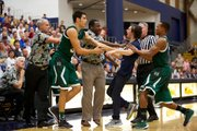 A rowdy UCSB student gets in the face of the Hawaii basketball team's head coach