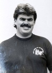 McElroy sports the mustache required of all males serious about a career in public safety.
