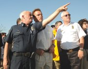 Governor Arnold Schwarzenegger listens to McElroy explain how the fire burned and how it was fought.