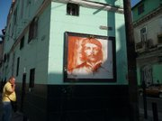 Street art honors Cuban civil war hero Che Guevara.
