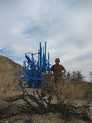 """BIG BLUE:  Author Charles Donelan with Gustavo Godoy's Ranch Project """"Big Blue"""" (2010-2013), which combines a wooden structure with blue paint and LED lights."""