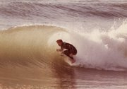 <b>SURFER HISTORIAN:</b>  Author Peter Maguire tucks into a Santa Barbara barrel, circa 1982.