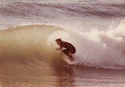 <b>SURFER HISTORIAN:</b>  Author Peter Maguire tucks into a Santa Barbara barrel, circa 1982.