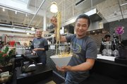 Empty Bowl Gourmet Noodle Bar co-owner Jerry Lee, with a bowl of northern Thai curry noodles.