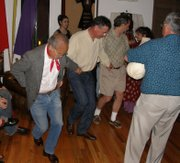 Luis Goena leading the dance at his 79th birthday party.