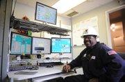 Venoco's Don Dixon mans the EOF's modern control room.