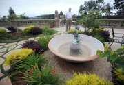 In addition to drought-resistant landscaping, Larry Reiche has turned off his fountains.